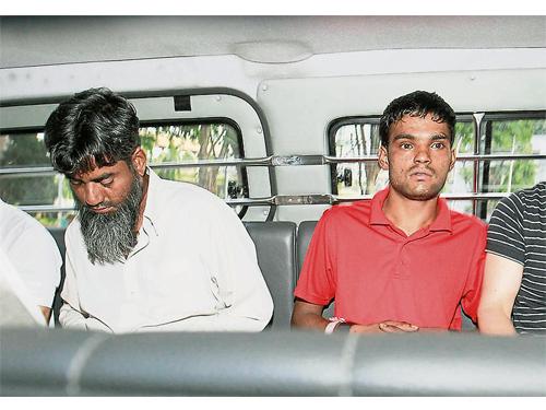 被告拉希德(左)和拉姆占(右),被判強制性死刑。(檔案照)