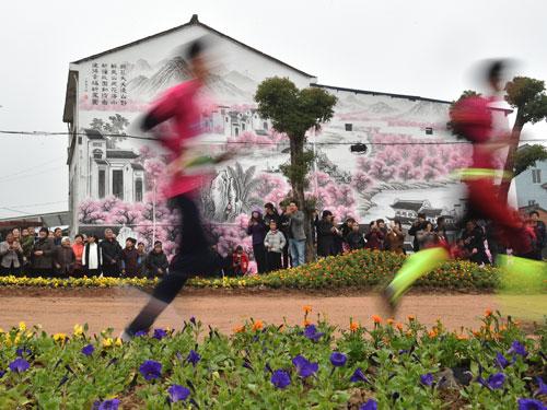 近來全球各地的馬拉松比賽,如雨後春筍,多到有興趣的跑者不知道如何取捨。(新華社)