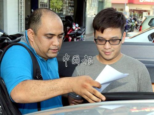 李宗聖被警方扣押往武吉阿曼警察總部。