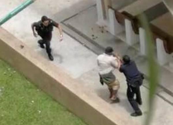 兩名警員在制伏狂漢時,被潑中稀釋劑受傷。