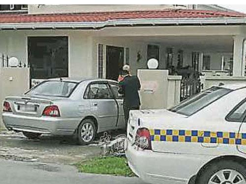 婦女被轎車夾斃在籬笆洋灰柱命案現場。