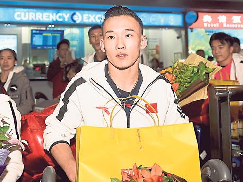 肖若騰填補了中國在男子全能世界冠軍榜的10年真空。(新華社)