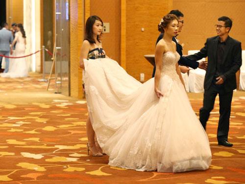 """2017年11月11日是""""雙11""""光棍節,在新加坡,共有336對情侶選擇在這天結婚。(檔案照)"""