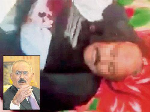 ■視頻截圖畫面顯示,薩利赫的屍體被搬到某處。(法新社)