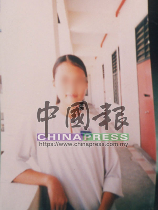 死者14歲的繼女邱雪盈(譯音)。