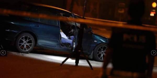 一名相信涉及打劫銀行的外籍悍匪,因拒絕截查與開槍,逼使警方還槍後被伏誅,死在車內。(照片取自網絡)