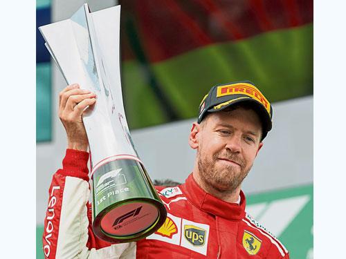 維特爾不但贏得第3個分站冠軍,還重新登上車手積分榜榜首,自然喜出望外。(美聯社)