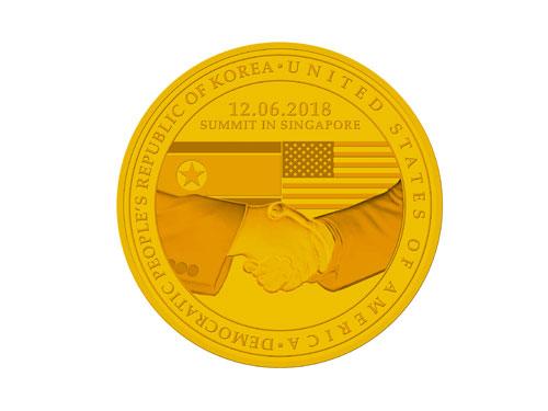 特金會金色紀念章。(路透社)