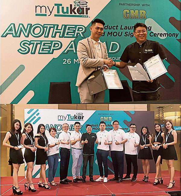 馮漢燊(上圖左)與GMR總執行長譚耀忠簽署合作諒解備忘錄后,握手合影。