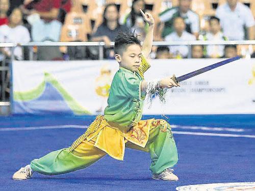 吉隆坡武術隊的最年輕世界冠軍杜浚赫。