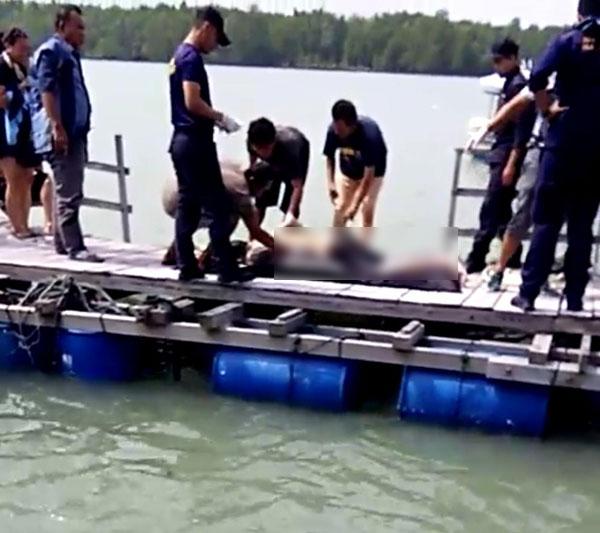 漁民和水警撈起遺體。