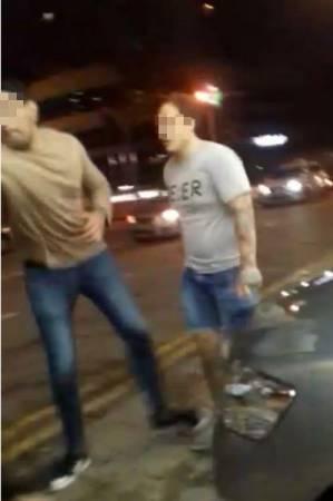 據悉,兩名攻擊受害者的男子是新加坡逃犯。