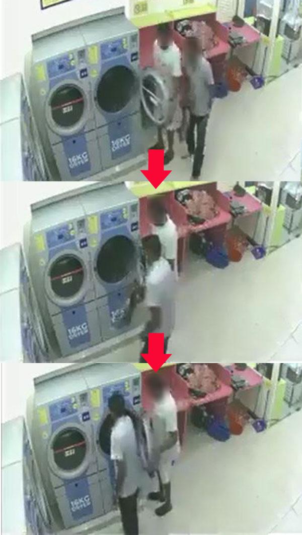 """兩名男子將貓放進烘衣機內再點擊""""開始"""",讓該貓活生生被烘死。(取自面子書""""Media Terkini""""網頁)"""