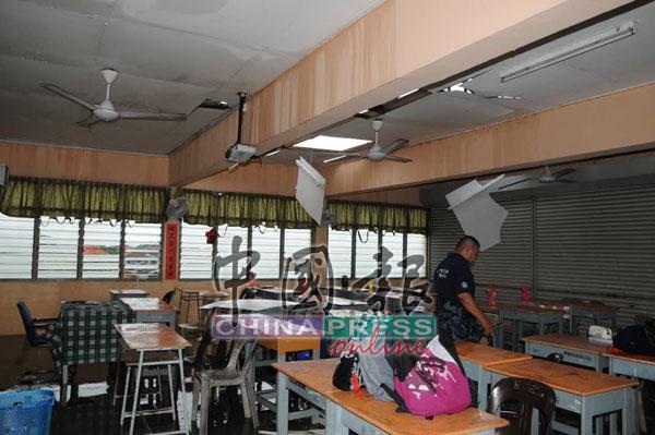 吉华华中风灾,锌板遭摧毁,雨水淋入课室。