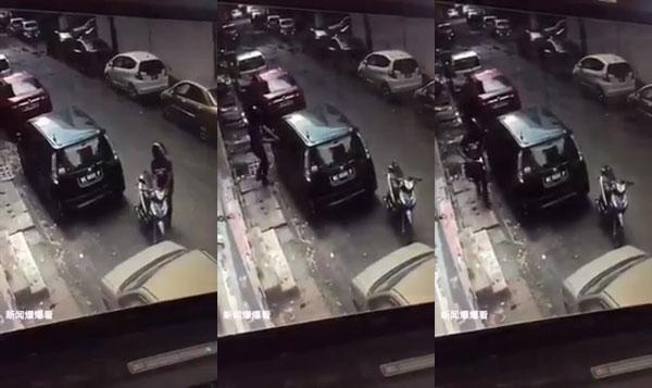 独行匪在光天化日之下撬开车窗,把留在车内的包包劫走,随即骑摩哆逃之夭夭。