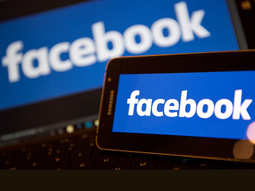FB动态消息将改版,讨论比按赞排序较前。(法新社)