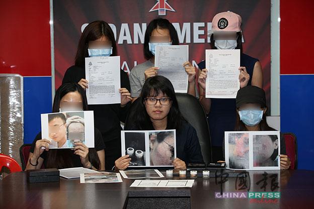 王诗棋(前排中)呼吁其他受害者报案。