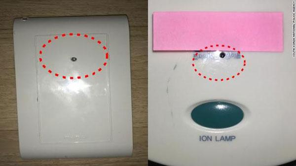 韩国警方指出针孔摄影机隐藏位置(红圈处)。(美国有线新闻网络)