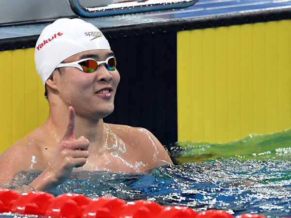 大器完成的何俊毅,藉今次中国游泳冠军赛一战成名。(新华社)