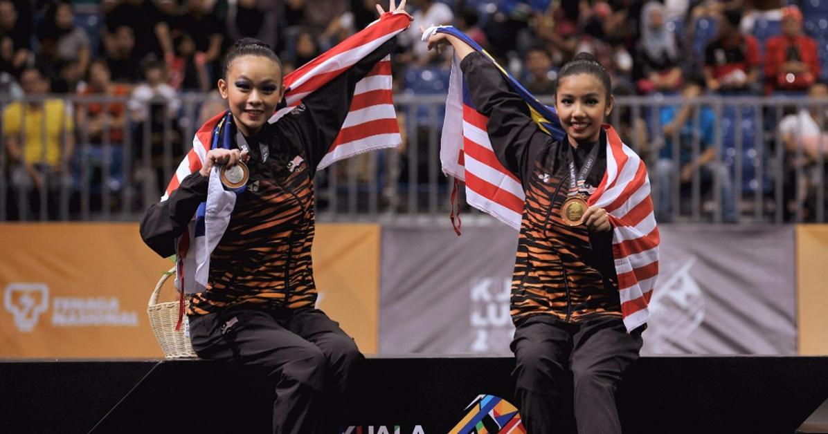 官狄雯(左)与郭雪嫣预计将率领韵律操队朝包揽东运5面金牌目标努力。