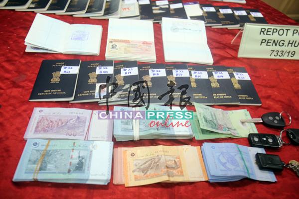 行动中起获的物品包括假印章、护照、假临时工作准证、假特别通行证、手机、3辆汽车、2辆摩哆及1万3750令吉现金。