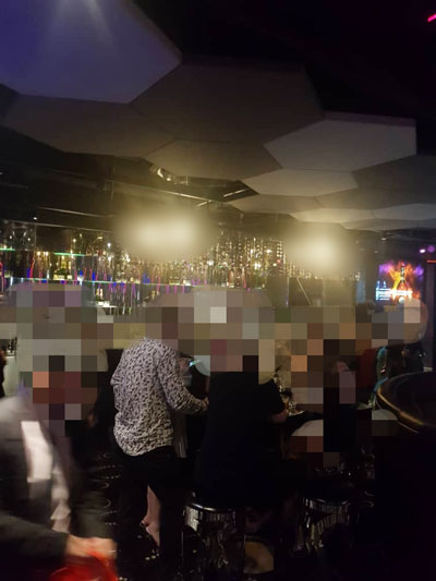 警方突击非法酒廊,盘查多名顾客,也逮捕10名中国籍陪座女郎。