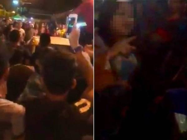 女子驾车误入斋戒月市场,因进退两难,遭群众包围,场面混乱。