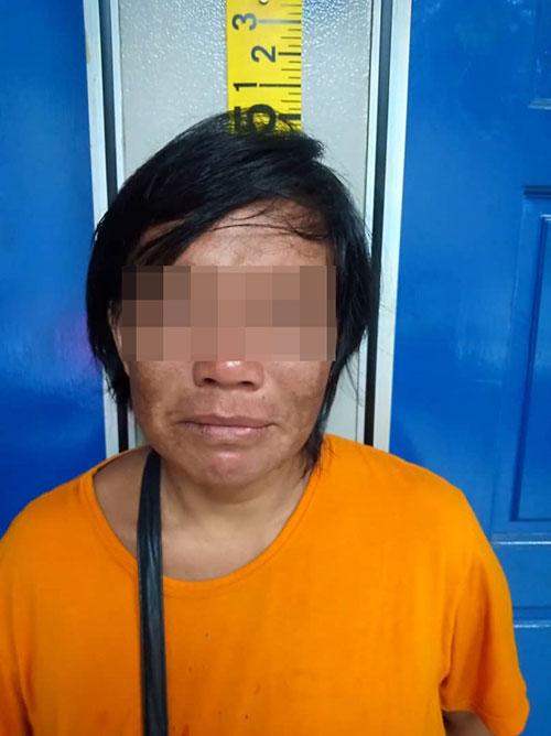 打伤丈夫的女嫌犯被捕助查。
