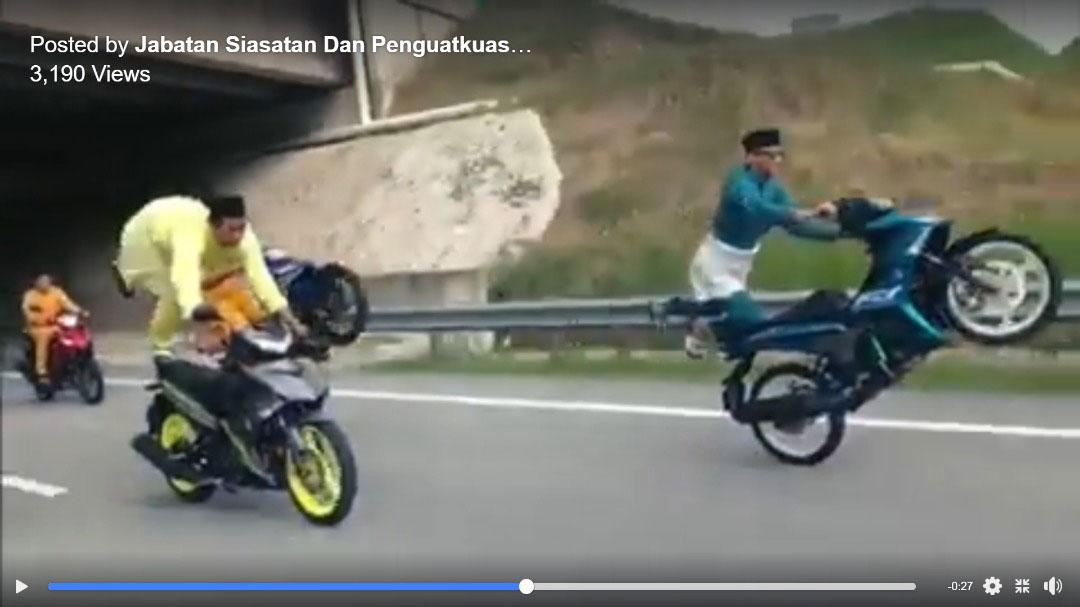 一群违规摩哆骑士在公路耍弄摩哆特技,让人看得目瞪口呆。