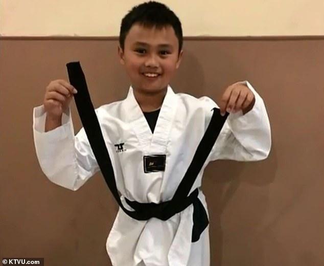 9岁的特里斯坦是跆拳道黑带。