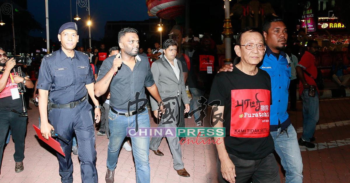 乌马甘丹(左2)和陈纹达(右2)被警方带离现场,以前往警局录供。