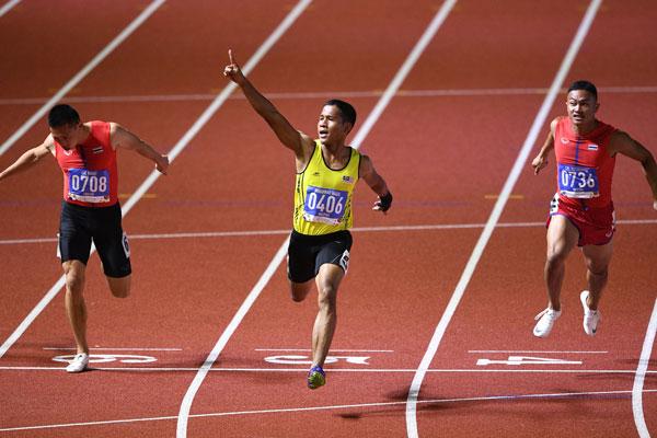 哈纳菲爆冷夺得男子100公尺金牌。(法新社)