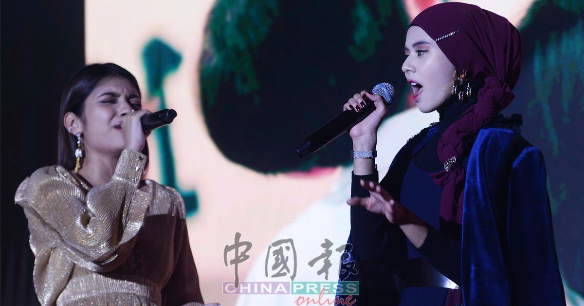 李佩玲(左起)及玛莎献唱《左肩》。