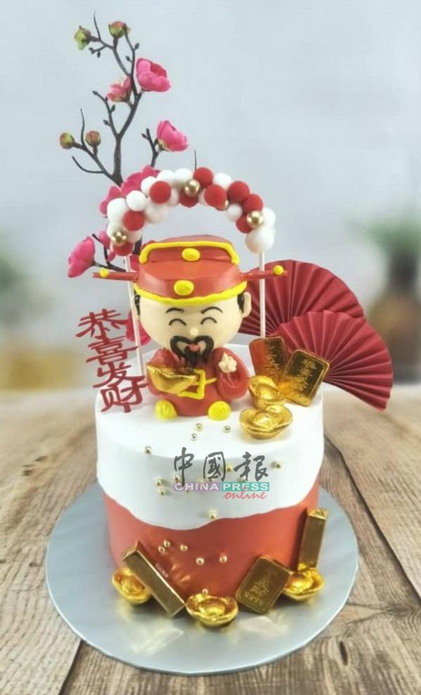 """""""财神爷""""造型蛋糕祝贺各界恭喜发财。"""