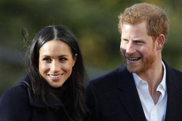 哈里王子与妻子梅根。 (美联社)
