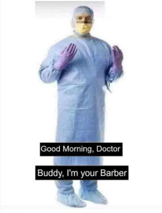 理发师穿上全副个人防护设备,准备就绪复业。