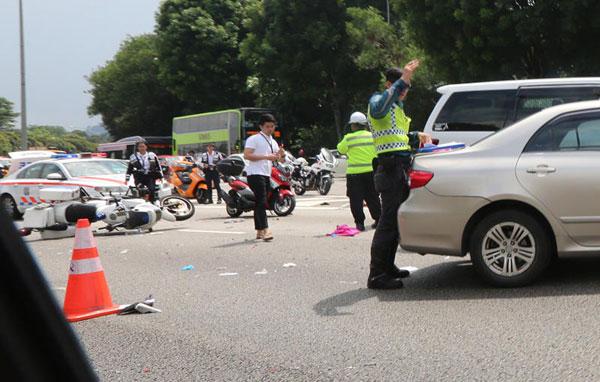 处理车祸现场的医疗人员和交警事后遭被告撞伤。(档案照)