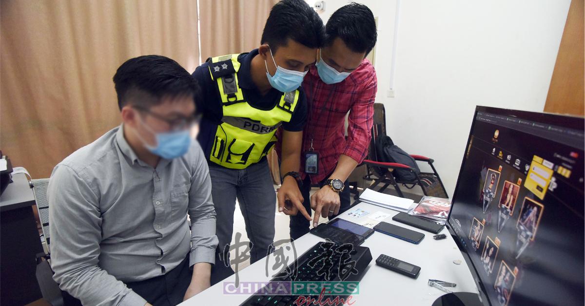 警员盘问其中一名落网者。