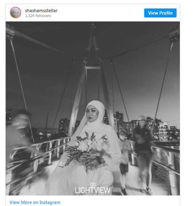 莎莎阿丽在社交媒体上载一张她单独拍摄的婚纱照。