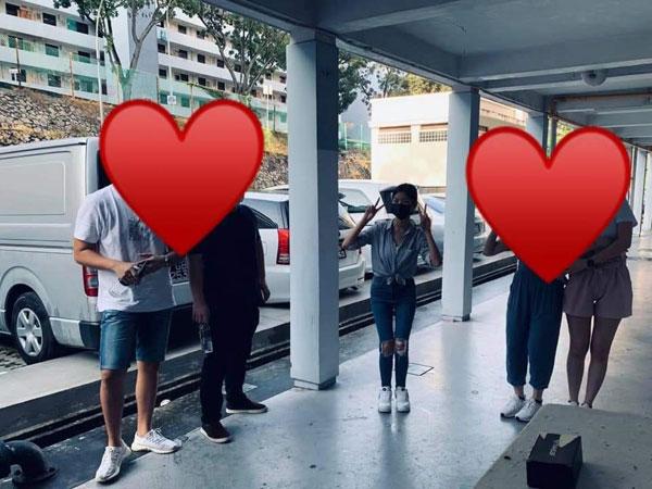 3名死伤者,包括胡秀惠和未婚夫乔纳森·龙,及陈永豪,在参与新年慈善活动时,和组织成员合影。(图取自:Hopes In Meals面子书)