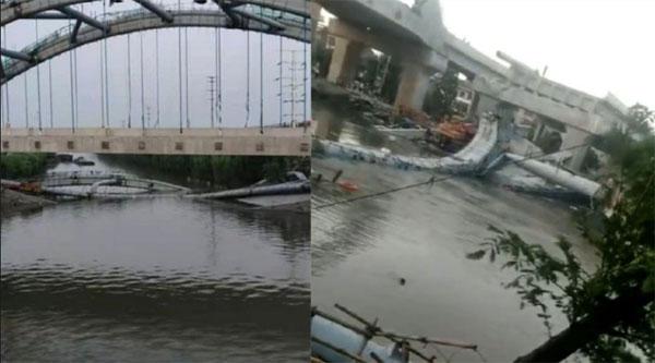 浙江绍兴一座施工中的桥梁倒塌,部分桥段掉到河里。