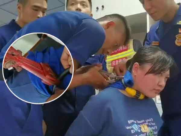 消防员用油压剪,小心的剪断密码锁。